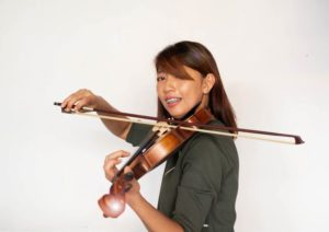 child playing musical instruments wearing braces